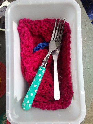 Crocheted Square for Silverware Drying - spoon and fork on red crochet square