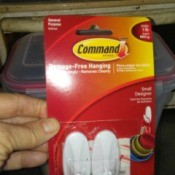 A package of Command plastic hooks.