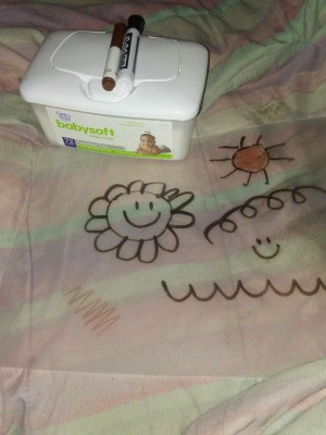 Children's drawings on a clear flexible cutting mat.