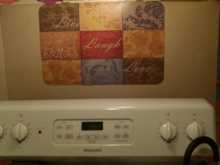 DIY Backsplash - placemat on wall behind stove