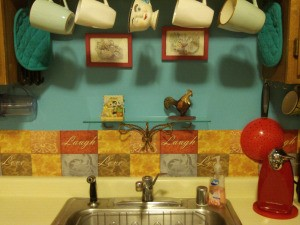 DIY Backsplash - aqua wall behind sink with the placemats cut in half and mounted behind sink