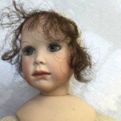 Identifying a Porcelain Doll - doll's head and upper body - porcelain and cloth