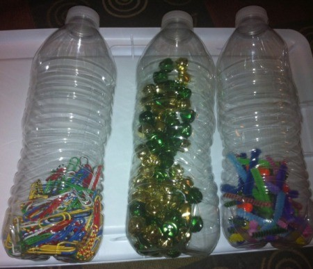 Magnetic Discovery Bottles - add cut up pipe cleaners, bells, and paper clips to each of three bottles, one type of inclusion per bottle