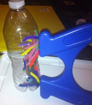 Magnetic Discovery Bottles - magnet against bottler with pipe cleaner bits