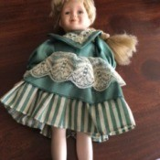 Identifying Doll Manufacturer - small doll with blond hair and green and white dress