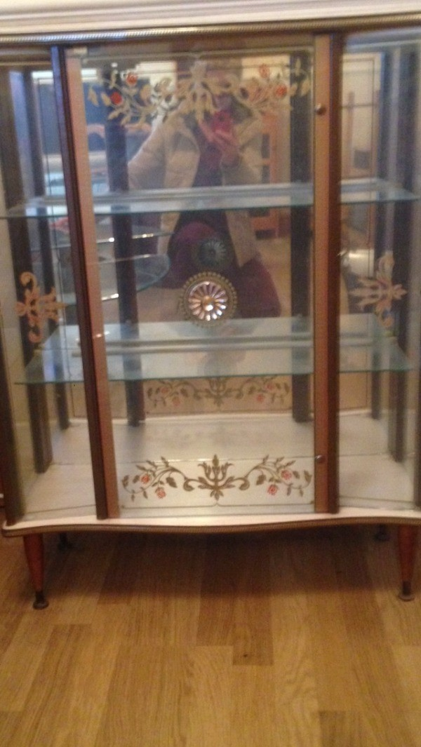 Value of Glass Front Cabinet - glass fronted cabinet with decorations on  doors and mirrored back - Finding The Value For Your Antique Furniture ThriftyFun
