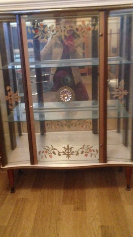 Value of Glass Front Cabinet - glass fronted cabinet with decorations on doors and mirrored back