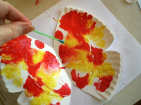 Make a Spring Butterfly from a Paper Plate - use brush to add details