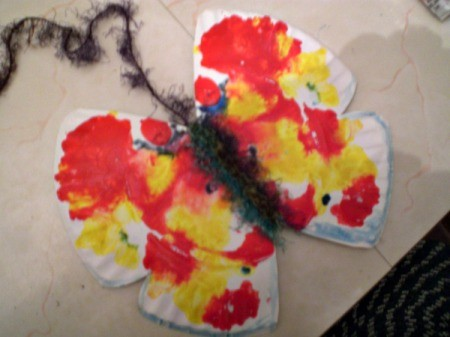 Make a Spring Butterfly from a Paper Plate - wrap yarn around the center fold for the body