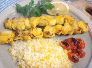 Chicken Kabobs, tomatoes and rice on plate