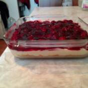 A no bake cherry cheesecake in a sheet pan.