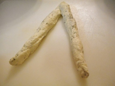 Two slender pieces of dough.