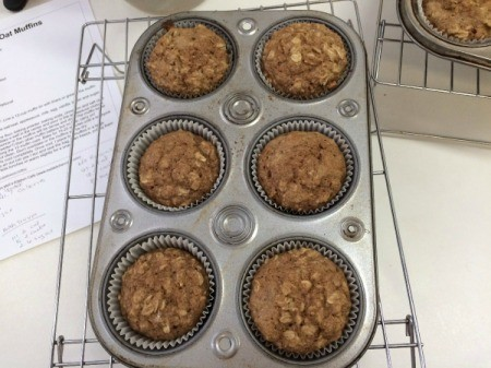 baked applesauce oat muffins in tin