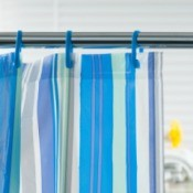 A blue striped shower curtain.