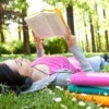 A woman reading books in the summer.
