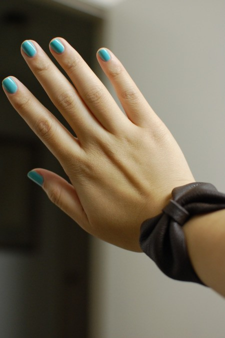 DIY Leather Bow Bracelet - woman's hand and wrist with bracelet on