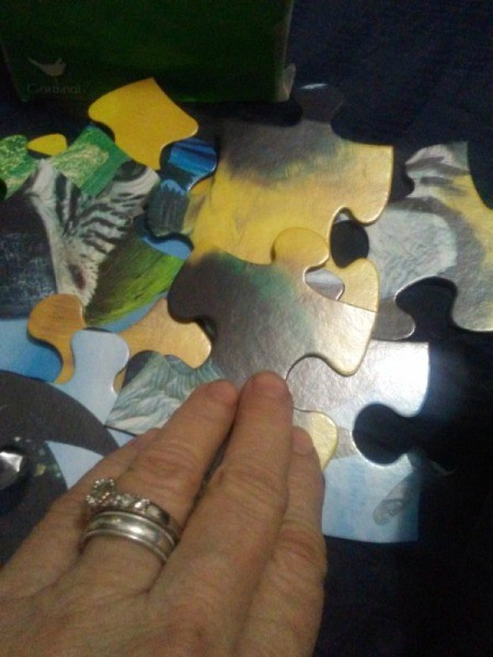 A jigsaw puzzle being put together.