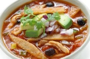 A bowl of chicken tortilla soup.