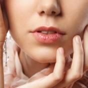 Chapped lips wearing lipstick.