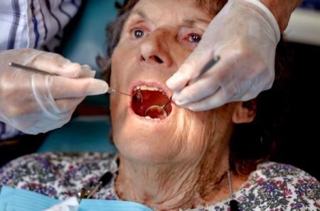 A woman receiving dental care.
