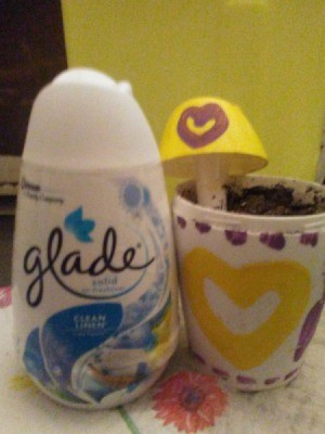 A planter made from a Glade air freshener.