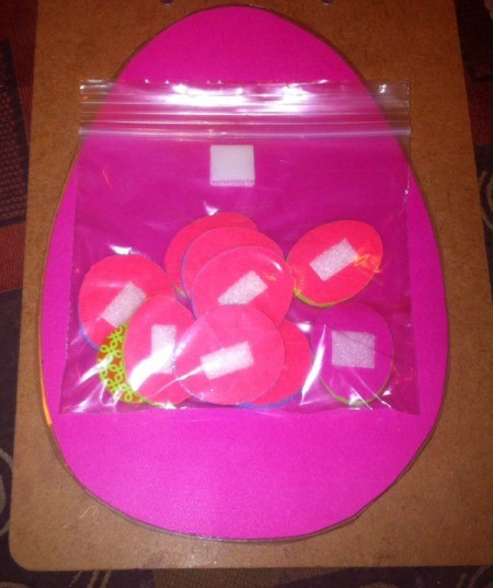 Easter Tic-Tac-Toe - plastic bag on back of board to store pieces