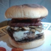 A homemade bacon mushroom Swiss burger.