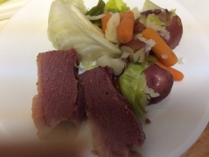 A plate of corned beef and cabbage.
