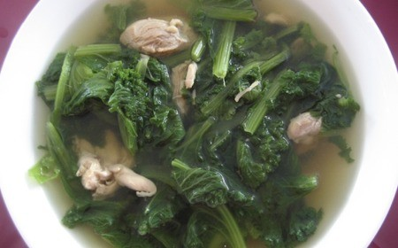 Mustard Green Soup with Chicken in a bowl.