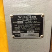 The serial number and manufacturer's tag on a Wurlitzer juke box.