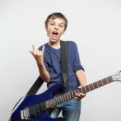 A boy playing an electric guitar.