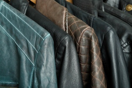 A row of leather jackets hanging up.