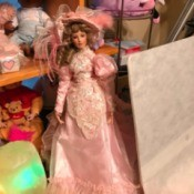 Identifying a Porcelain Doll - doll in fancy 1890s style pink dress