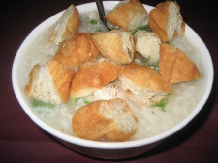 cut up Chinese donuts on plate (Congee)