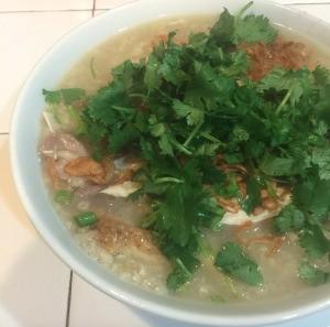 Chicken and Rice Porridge garnished in bowl.