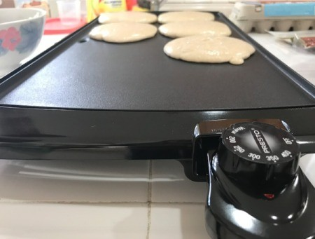 Pancakes on an electric griddle.