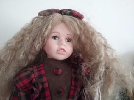 Selling Porcelain Dolls - doll wearing plaid