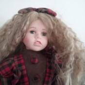 Selling Porcelain Dolls - doll wearing plaid