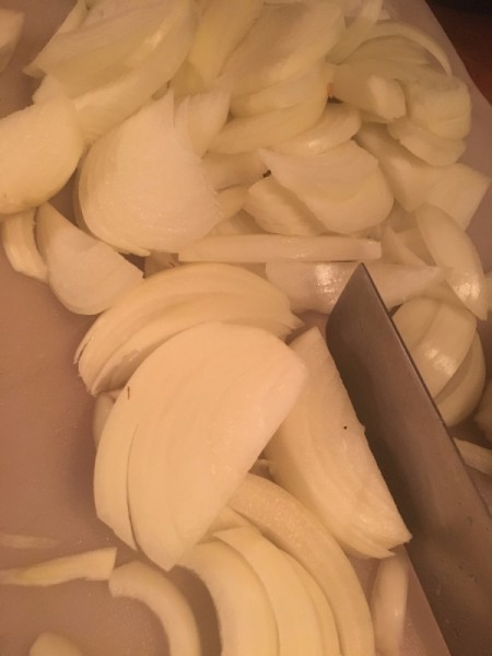 slicing onions for French onion soup.