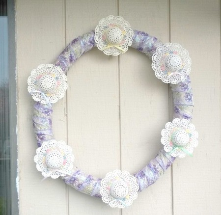 Mini Hat Spring Wreath - finished wreath hanging on porch wall
