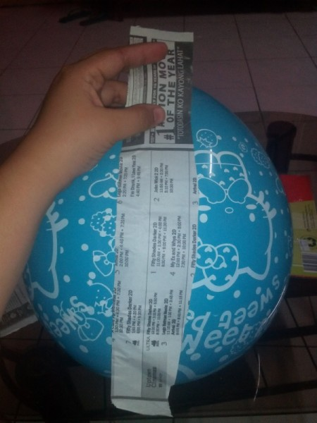 DIY Piñata - begin to glue strips of paper to balloon