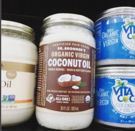 Bottles of coconut oil at a supermarket.