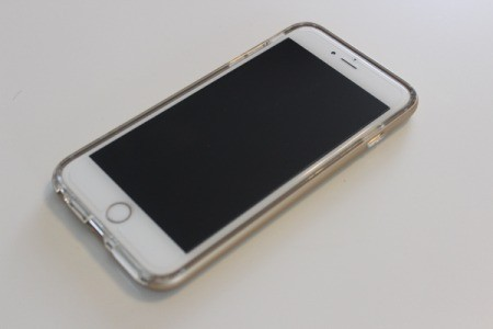 An iphone with a glass screen protector.