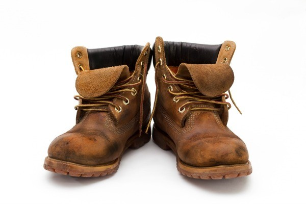 Dealing with foot odor from work boots thriftyfun a pair of well worn work boots on a white background solutioingenieria Choice Image