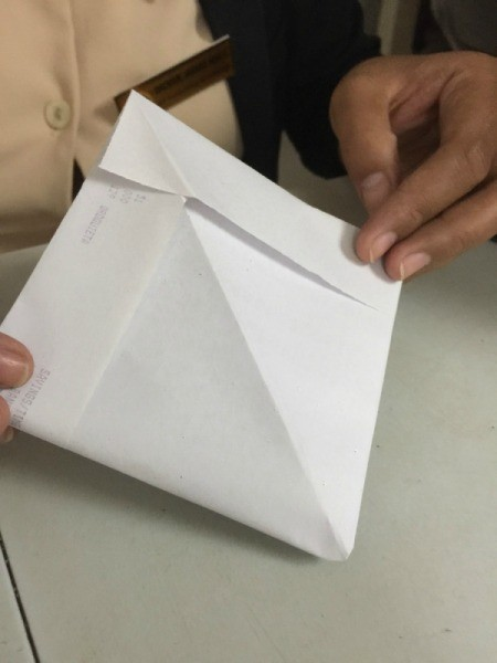 Folded Paper Box - open the triangle and fold opposite sides together