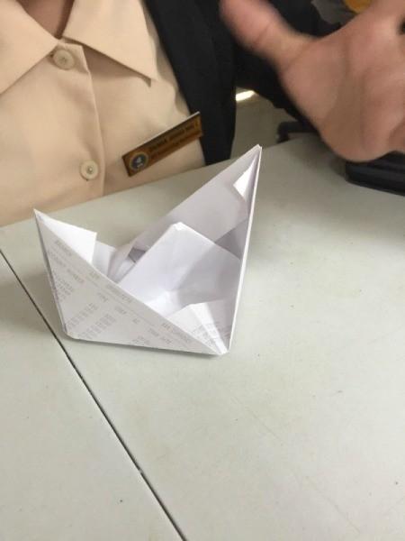 Folded Paper Box - open until it resembles a boat