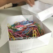 Folded Paper Box - box filled with colored paper clips