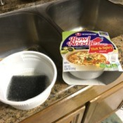 A noodle bowl being reused as a soap dish.