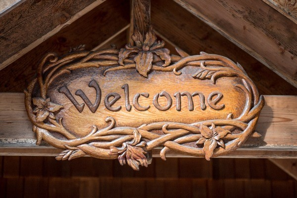 A wooden carved welcome sign at Breitenbush.