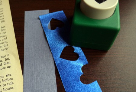 Punched Paper Bookmark - Randomly cut shapes along the paper strip using your paper punch.
